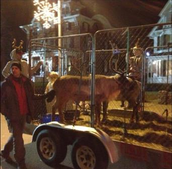 Dr. Joe Martins, DVM, walks along with Reindeer Float.