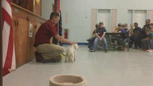 Dr. Joe Martins, DVM, petting Peanut