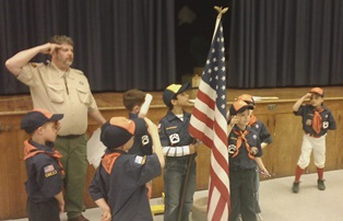 Cub Scouts saluting the flag