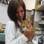 Dr. Heather Simon and cat patient Cedric.