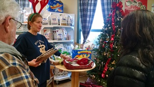Helene explains raffles to visitors at Belle Mead Animal Hospital 2014 Open House and Reindeer event