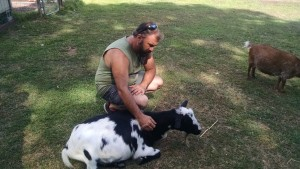 Mark Sopko, BMAH Vet Technician with Goat at Triple C Ranch
