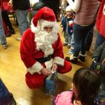 Santa Claus giving goodies