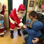 Santa gives out goodies